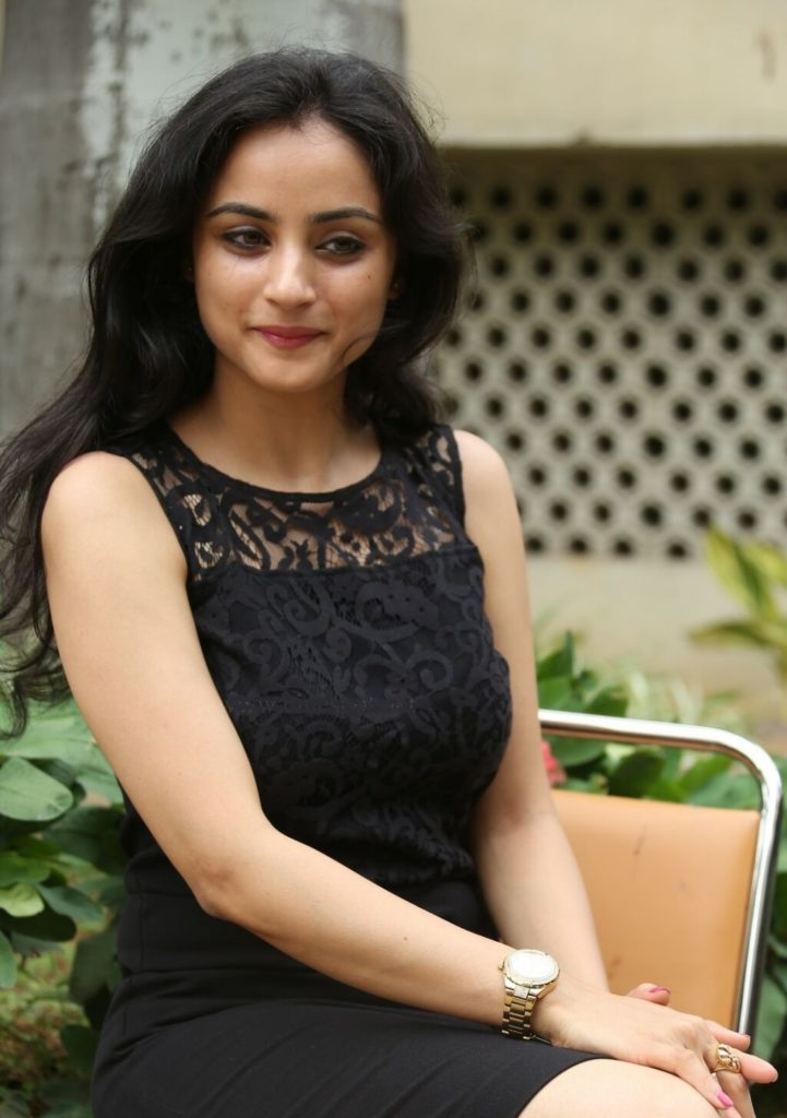 Madirakshi Mundle Cute Pics In Black Dress